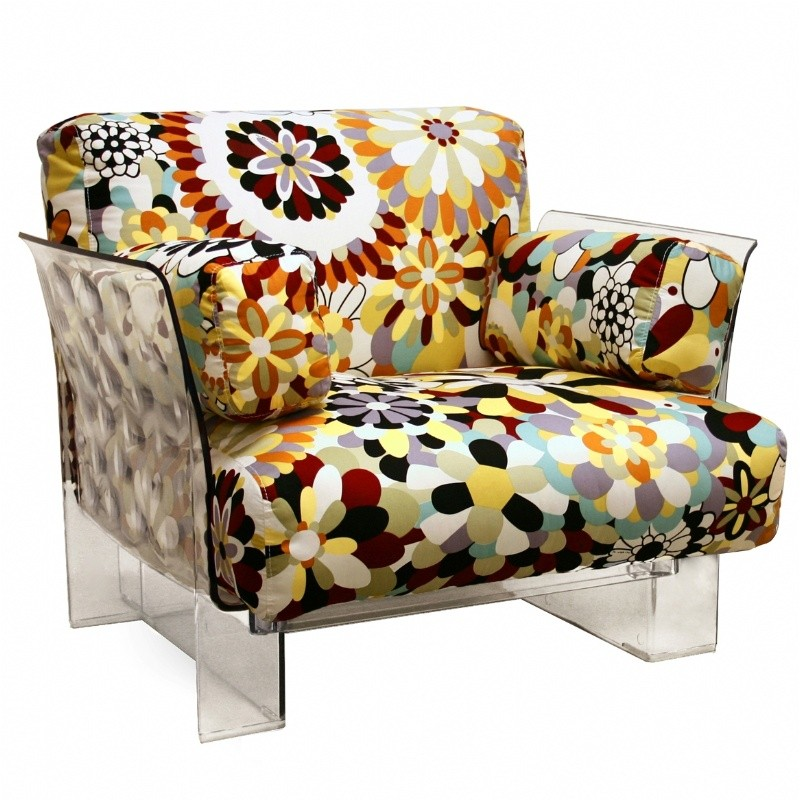 Clear acrylic accent chair with floral cushion